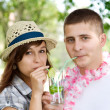 Cute couple drinking mojito coctail — Stock Photo
