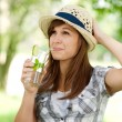 Woman drinking mojito — Stock Photo