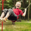 Stock Photo: Little boy swinging
