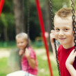 Stock Photo: Children swinging together
