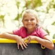 Portrait of little girl on playground - Stock Photo
