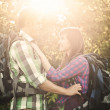 Loving couple in forest at sunset — Stock Photo