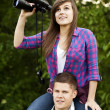 Young couple in forest — Stock Photo #21908509