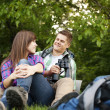 Stock Photo: Couple sitting on glade