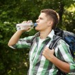 Hiker drinking water in forest — Stock Photo #21908799