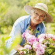 Senior woman with flowers — Foto Stock