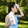 Tired woman after jogging — Stock Photo