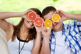 Young couple having fun with fruits — Stock Photo