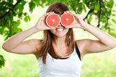 Woman having fun with fruits — Stock Photo