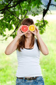 Young woman having fun with fruits — Stock Photo