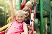 Children on slide — Stockfoto
