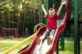 Active boy sliding down — Stockfoto