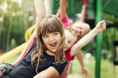 Kids having fun on slide — Stock Photo