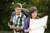 Young couple in forest — Stock Photo