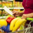 Senior woman at supermarket — Stock Photo #21915863