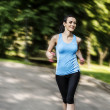 Active woman jogging with dumbbells — Stock Photo