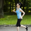 Active woman jogging — Stock Photo