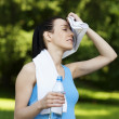 Tired woman after jogging — Stock Photo #21910069