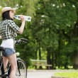 Cyclist drinking mineral water — Stock fotografie