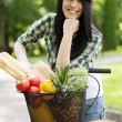 Beautiful young woman with bike — Stock Photo #21910179