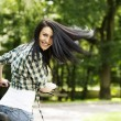 Woman with bike — Stock Photo #21910211