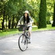 Woman riding a bicycle — Stock Photo #21910273