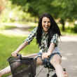 Woman cycling through the park — Stock Photo #21910289