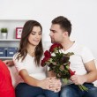 Loving couple with red roses — Stock Photo