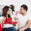 Stock Photo: Woman opening a valentine's gift