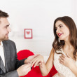 Man putting a wedding ring on his girlfriend's finger — Stock Photo #21911367
