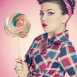 Retro sexy woman with large lollipop — Stock Photo