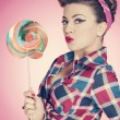 Royalty-Free Stock Photo: Retro sexy woman with large lollipop