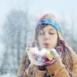 Woman blowing snow to away — Stock Photo