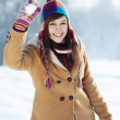 Woman throwing snowball — Stock Photo