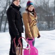 Young couple together in the snow — Stock Photo