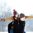 Young man giving his girlfriend a piggyback ride — Stock Photo