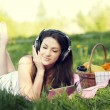 Young womlistening to music — Stock Photo #21913085