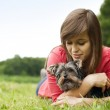 Young woman holding Yorkshire terrier — Stock Photo