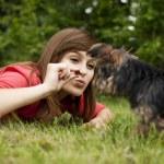 Woman feeding puppy — Stock Photo #21914433