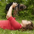 Woman holding cute puppy — Stock Photo