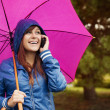 Young woman under pink umbrella — Foto Stock