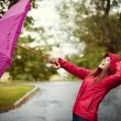 Young woman with pink umbrella - Stock Photo