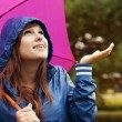 Young woman under pink umbrella — Stock Photo #21915637