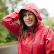 Stock Photo: Young womin raincoat