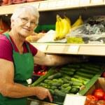 Senior woman at supermarket — Stock Photo #21915717