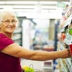 Senior woman at supermarket — Stock Photo #21915723