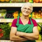 Senior woman at supermarket — Stock Photo #21915731