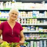 Senior woman at supermarket — Stock Photo #21915737