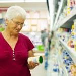 Senior woman at supermarket — Stock Photo #21915743
