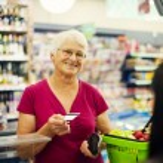 Senior woman at supermarket — Stock Photo #21915753